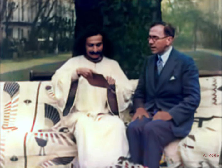 19. Mid-September 1931 : Meher Baba sitting in the common garden at the Davey's house in Kensington, London with Charles Purdom giving an interview for Paramount Films newsreel.
