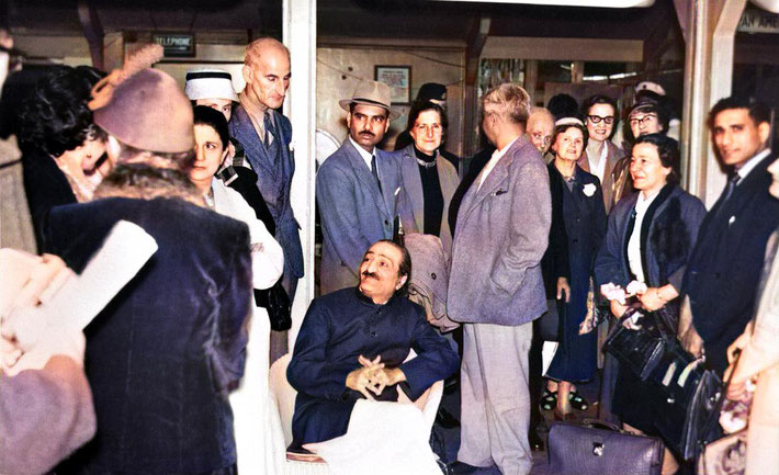 1956 : London Airport - Meher Baba with his men Mandali waiting to get the contecting plane to go to New York. The English Meher Baba group came to be with Baba whilst he waited. Image colourized by Anthony Zois.