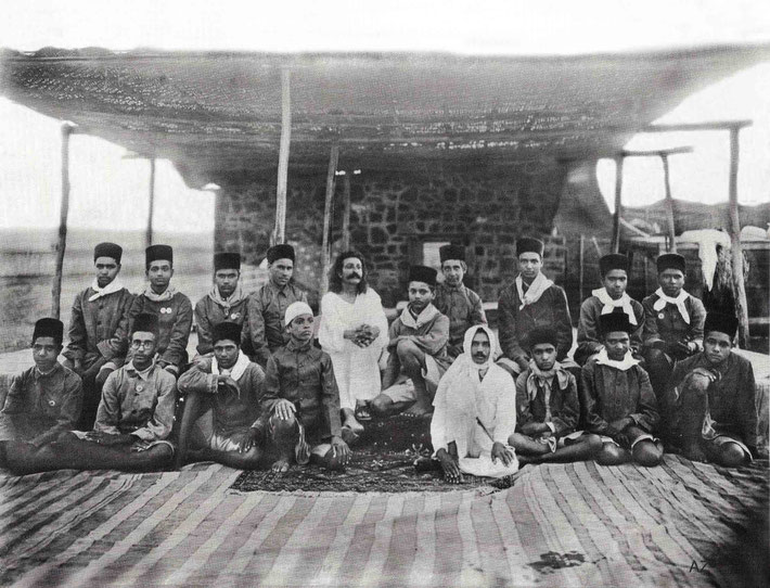 Upper Meherabad, India - 1927 : Meher Baba with boys from the Hazrat Babajan School seated in front of the crypt. Photo takeb by S.S.Dean - Courtesy of Beloved Archives - Flow International magazine Spring 2016  also  LM page 955. Agha Ali with white cap.