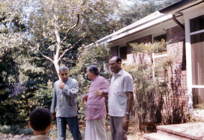1958 : Meher Baba assisted by Adi K. Irani ( left ) & Nariman Dadachanji ( right ) at Meher Abode with Larry looking on at Mrytle Beach, SC.