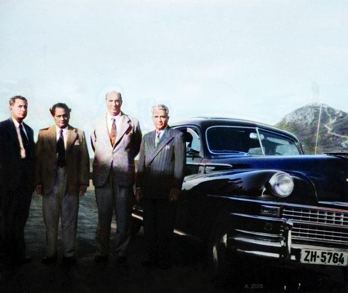 The some of the men Mandali pose on their way to Locarno next to the 1947 Chrysler motor vehicle which transported Meher Baba & his women Mandali. ( L-R ) Meherjee Karkaria, Dr. Nilu Godse, Sarosh K. Irani & Adi K. Irani. Image colourized by Anthony Zois.