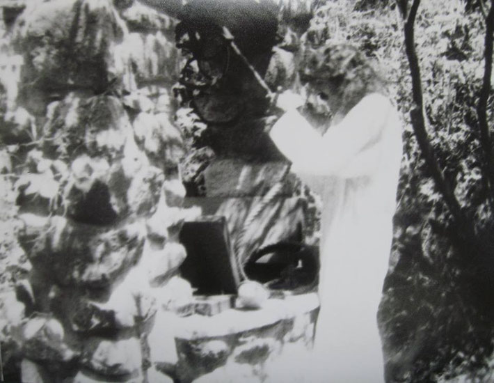 Meher Baba pulling the bucket at the well at Harmon