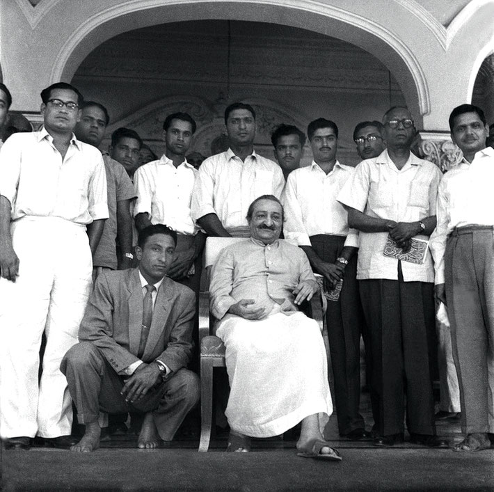 "2nd April 1959 - Guruprasad, Poona, India, the Indian Cricket team posing with Meher Baba, some are holding copies of Baba's book ""Life at its Best"". Polly is standing behind Baba. Photo taken by Meelan"