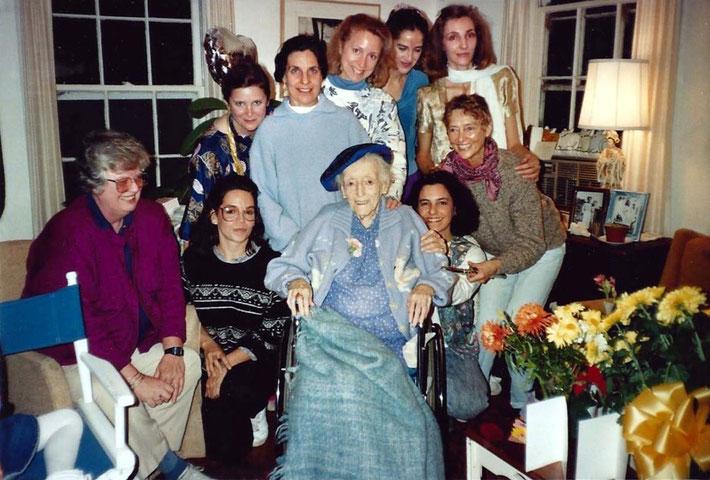 Margaret Craske's birthday with Ann Conlon(L) & Debbie Kramer (both seated), Sally Haviland, Yvonne Riley, Malinda McCulloch,Dana Ferry,Beth McKee, Ambika Sharan (crouching),Barbara Connor (kneeling)at Happy House on the Meher Spiritual Center Nov.26 1989