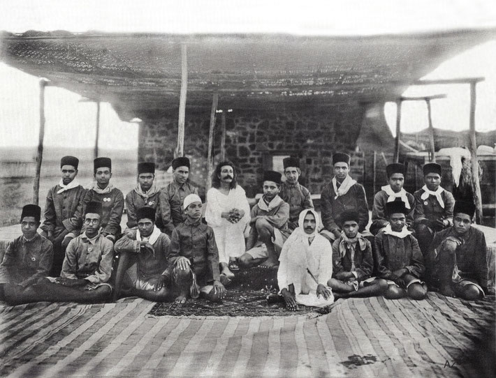 Upper Meherabad, India - 1927 : Meher Baba with boys from the Hazrat Babajan School seated in front of the crypt. Photo takeb by S.S.Dean - Courtesy of Beloved Archives - Flow International magazine Spring 2016  also  LM page 955