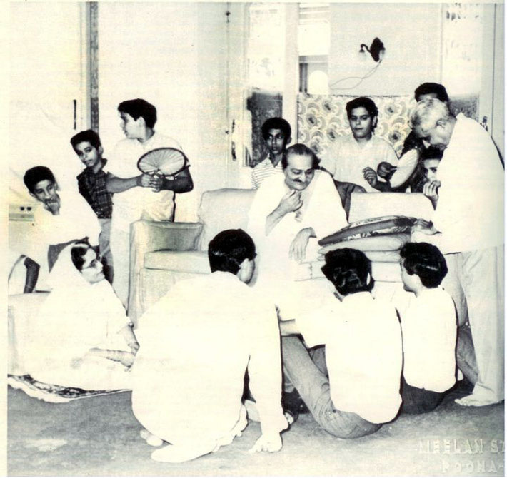 Guruprasad, Poona, India : Meher Baba gesturing to the Luck Brothers with Adi K Irani standing on far right.