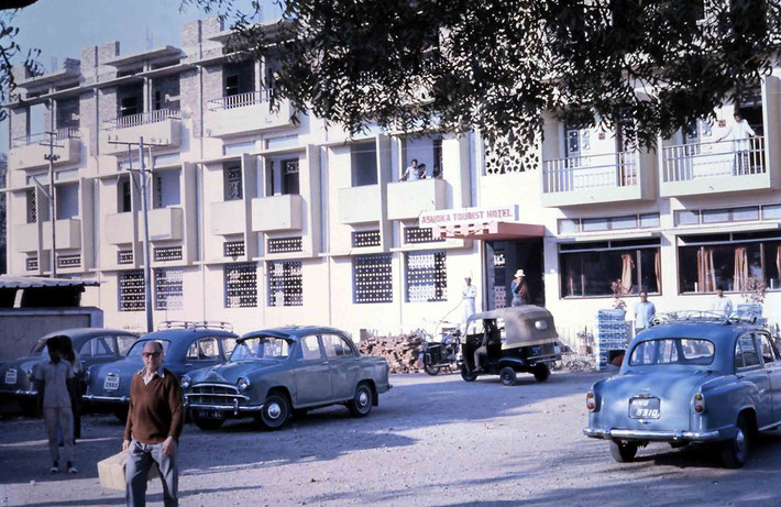 Reg outside the Ashoka Hotel in Ahmednagar - Jan.1975 ; Photo by Anthony Zois. Bill Le Page is in the doorway of the hotel.