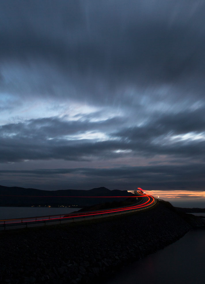 Atlantic Road after sunset with red trail of a car as long exposure, coastline, Norway, 1280x1772px