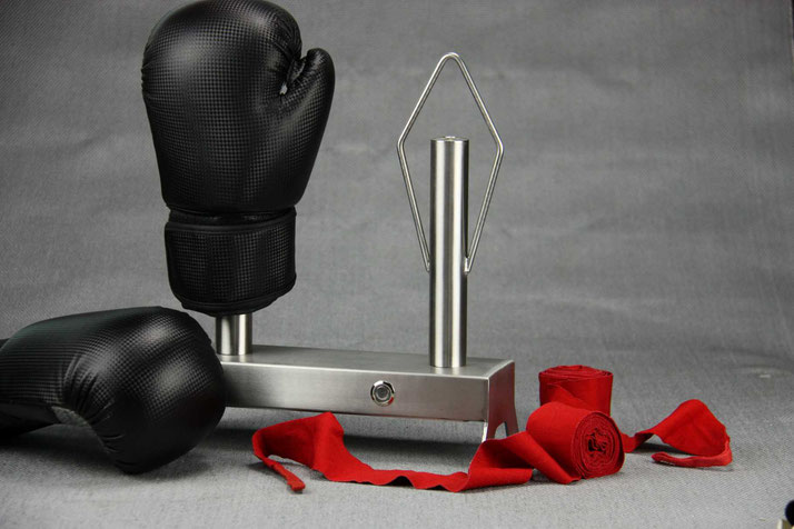 stainless steel boxing glove dryer with boxing gloves and red handwraps on a grey background