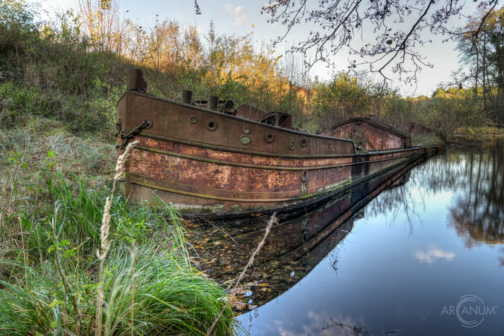 This rusty old barge is the only remaining remnant of a large former brick port