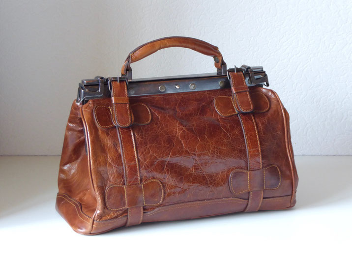 Lederpflege Tasche