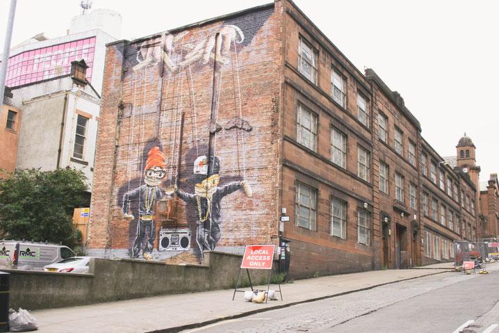 Glasgow Scotland UK ofpenguinsandelephants of penguins and elephants graffiti Marionettes
