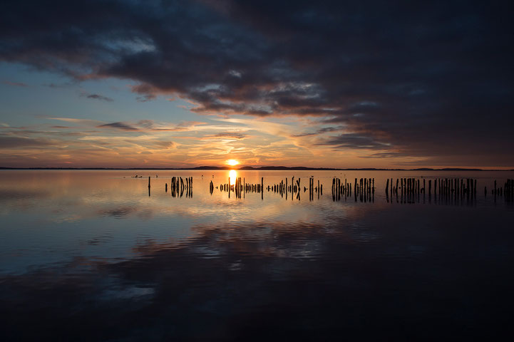 Sunset view of the Grsser Jasmunder Bodden with dramatic color and reflections, Polchow, Ruegen, Baltic Sea, Germany, Europe