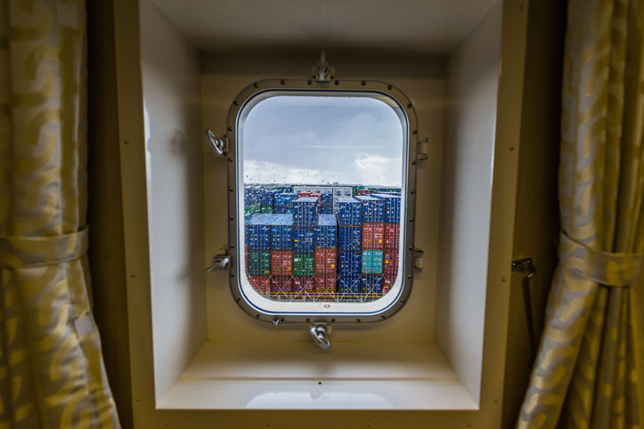 Container ship window looking to the containers