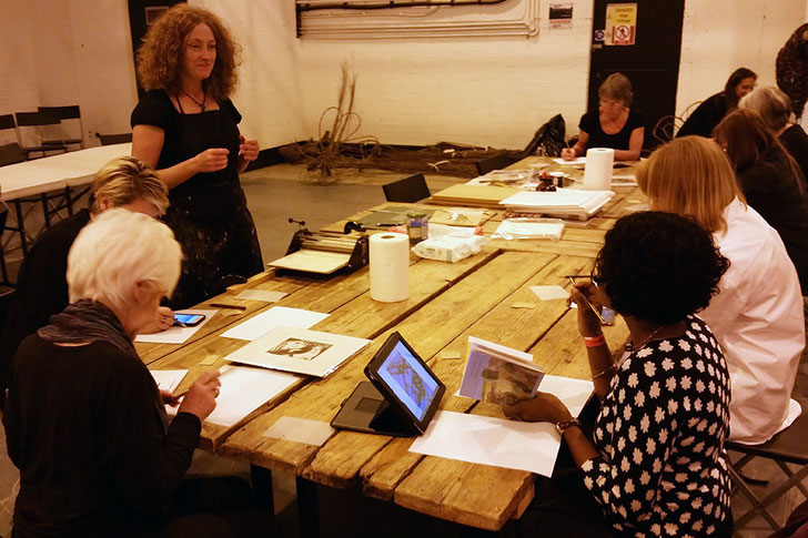 Lucy running a drypoint etching printmaking workshop at the Great Northern Contemporary Craft Fair