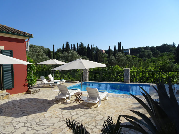 Spacious patio with parasoles, sun loungers and wonderful views over our valley!!