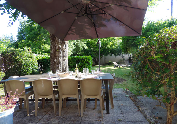 Le Tilleul private garden with 12 seated outside table
