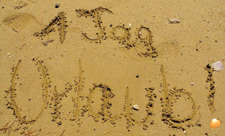 Sand mit Text ein tag Urlaub