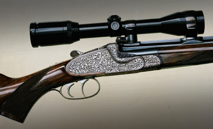 Relief chasing engraving work on a break action single barrel rifle