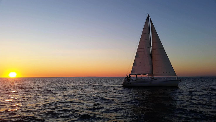Sailing at sunset - White Wake Sailing