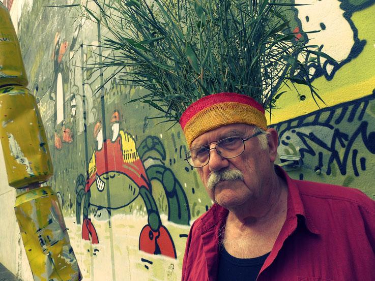 Der letzte Mohikaner by © Pedro Meier, Fluxus DADA Climate Change Performance, Installation: Bamboo, trash found alu beer cans. Homage to the indigenous Amazon peoples, Native American Indians, Gesamtkunstwerk. Graffiti Attisholz. Visarte – SIKART Zürich