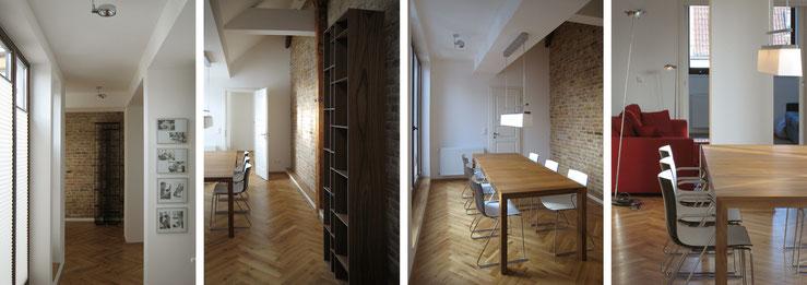 Massivholz-Regal vor Sichtmauerwerk, Sofa und ausziehbarer Esstisch mit Pendelleuchte, Steh- und Deckenleuchten