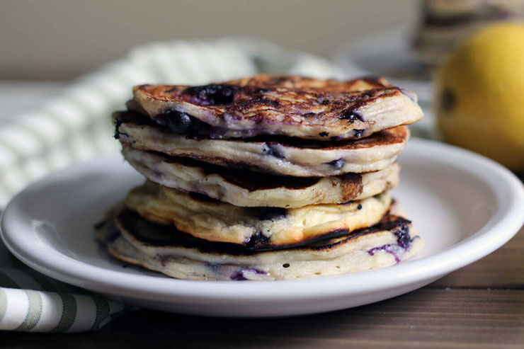Ready for a delicious morning? If you love the idea of protein pancakes without protein powder, you'll want to make these lemon blueberry ricotta pancakes.  #healthypancakes #proteinpancakes #pancakerecipe #breakfastrecipes