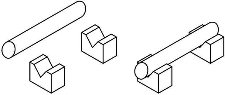 Vブロックに円柱を置くと円柱の中心を出すことができます。