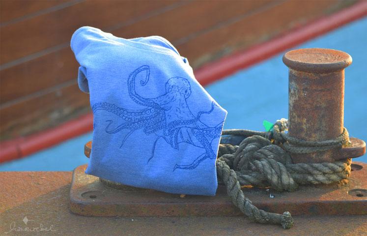 honourebel online brand store honourebel kids common octopus t-shirt on bollard at harbour at sunset
