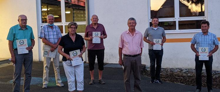 Das Bild zeigt die Geehrten (von links nach rechts): Wolfgang Reinhart, Berthold Fischer,  Rosemarie Waldherr, Eike Grieger, Klaus Neckermann, Michael Graf, Fritz Uihlein.