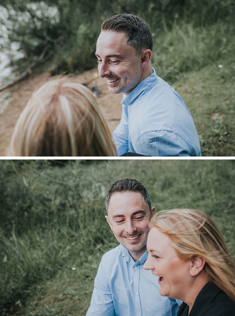 A couple smiling and laughing whilst having engagement photographs taken