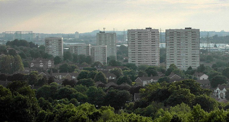 The blocks of flats on the Bromford estate; the low-rise houses among the trees in the foreground are on the Firs estate. In the distance can be seen the Dudley hills.