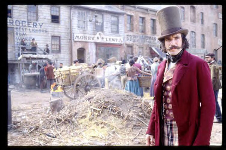 Starring / Daniel Day-Lewis / Gangs of New York / Leading Role / Cone Hat / Carriage / Hay / In the Background a Wooden Carriage / Banking Institute