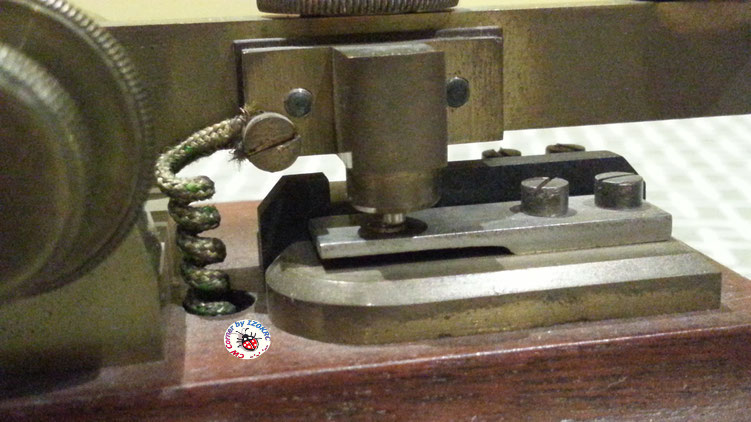 Hasler Telegraph key  for Duplex morse system  -  particular of rear/right electrical contact and deelay wire coil