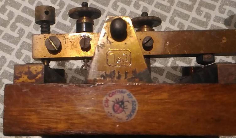 """Siemens & Halske """"Imperial Key"""".  Particular of workshop logo engraved on the frame"""