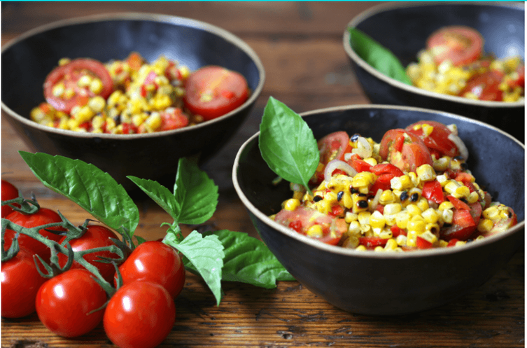 Love a good grilled corn salad? You will love this fresh corn and tomato salad with honey lime dressing. Plus, tips for cooking with summer fruits and vegetables. #fruit #vegetables #cornsalad #honeylimedressing