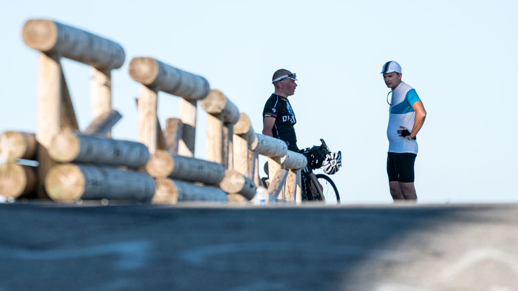 A Frenchman and a Dutch cyclist chatting after making the summit.