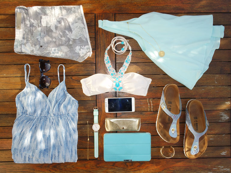 Flatlay of blue clothes and accessoiries