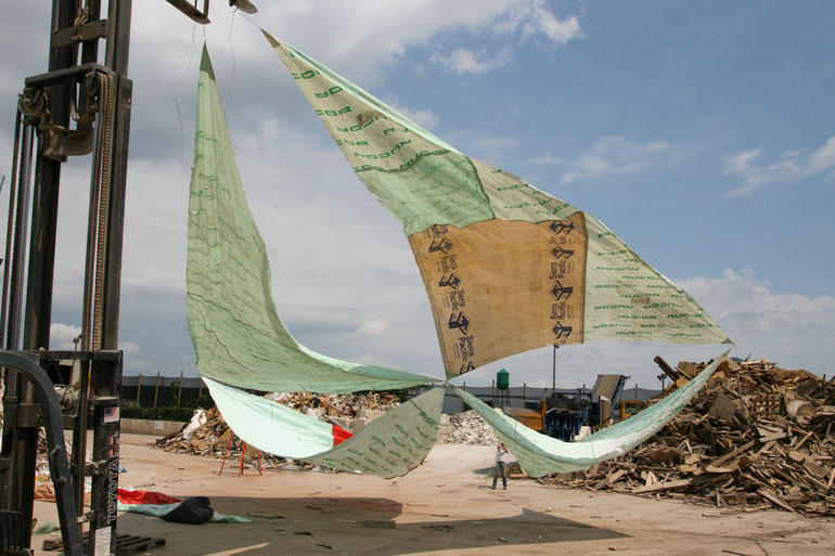 """Untitled (flying sails)"", Installation Recycling Artist in Residency (RAIR) in Philadelphia, PA, forklift, discarded plastic and tyvek, rope, person, 2011"