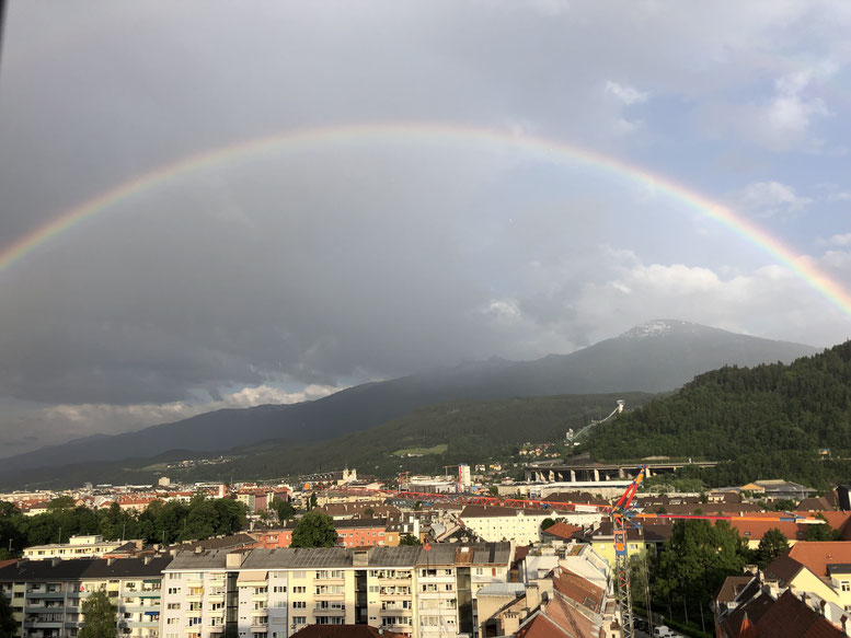Photo by Irene Huber: Rainbow over Innsbruck