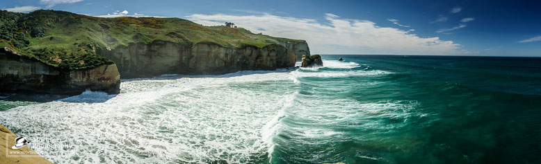 coastline with big waves and wonderful green and blue water
