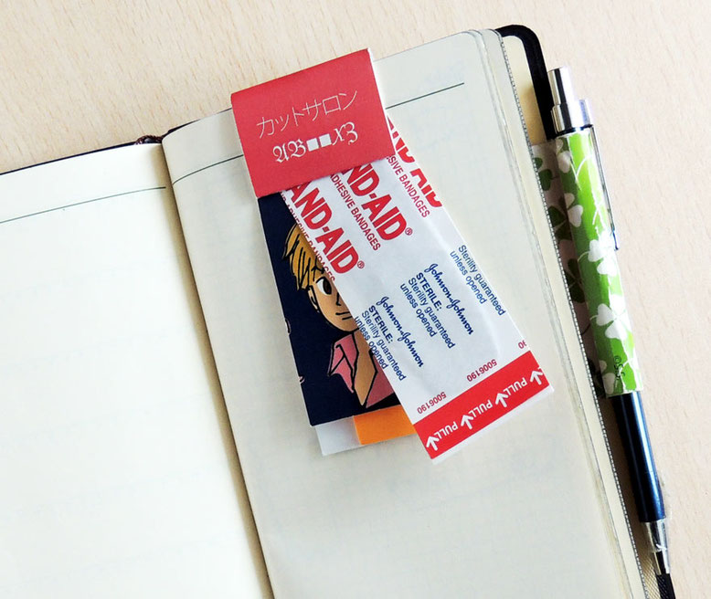 携帯付箋クリップ。絆創膏をクリップして使ってもらう。便利でユニークな付箋です。