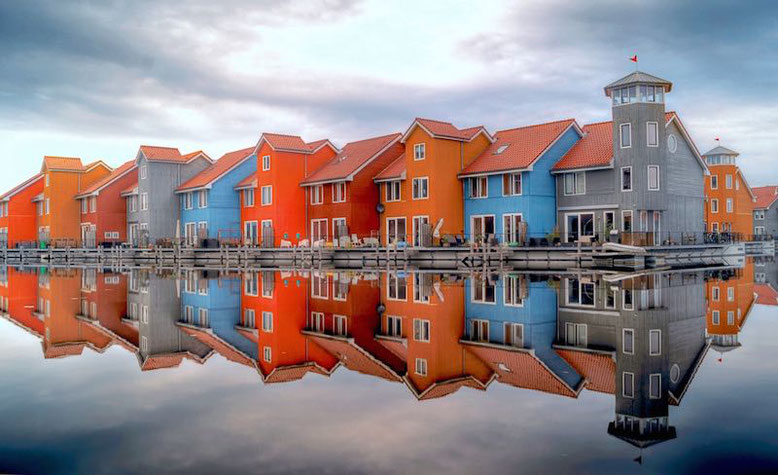 Colorful houses reflection in Reitdiephaven Groningen, Netherland