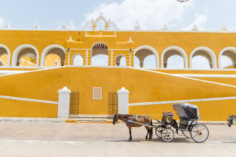 yellow colored building in Izamal, Mexico