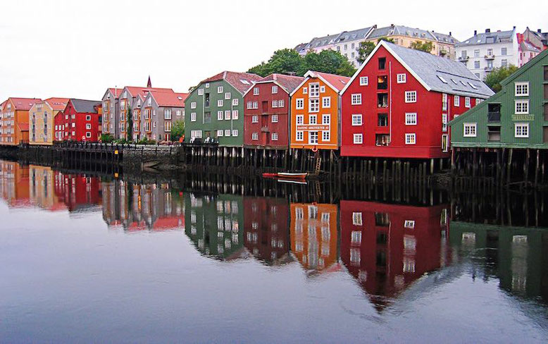 water reflection of colorful houses in Norway