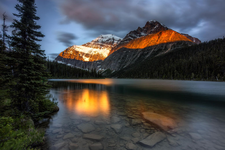 Mount Edith Cavell reflecting in Edith Cavell Lake. Best photography spots in Jasper National Park