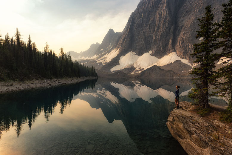 The Rockwall reflecting in the Floe Lake. Guide to the Rockwall Trail.