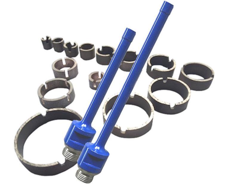 voor het boren van gaten in gewapend beton om bijvoorbeeld ankers te plaatsen, op deze foto 2 boren en verschillende ringsegmenten