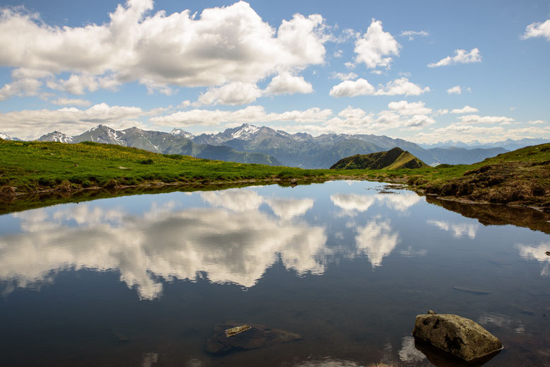 Clear mountain lake and reflections of clouds in the sky