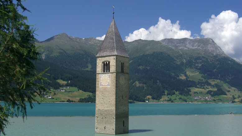 Enjoy Your holidays in South Tyrol at the lake of Resia. The tower or church in the water is the simbol of South Tyrol.